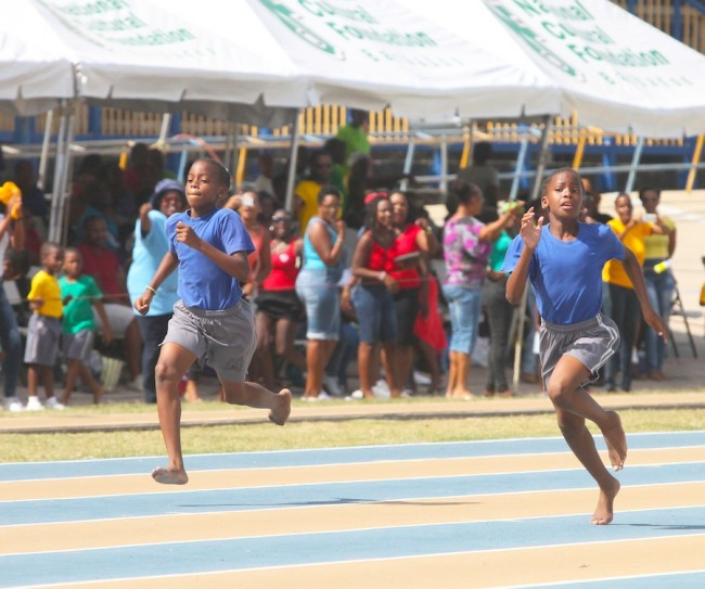 (From left) Identical twins Tania and Tia Applewhaite came into the world together but  today at St Giles' Inter-House Sports Day they gave no quarter while competing against each other for  Adams House. (Picture by Morissa Lindsay)