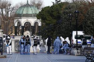 Police forensic officers attending the scene after an explosion in front of the German Fountain in Sultanahmet Square in Istanbul, Turkey, today.