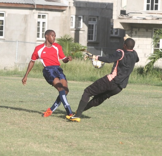 St Lucy goal-scorer Shaquon Hippolyte (red & blue) placed the ball past St James South's goalkeeper Akeem Scott and into the back of the nets. (picture by Morissa Lindsay)
