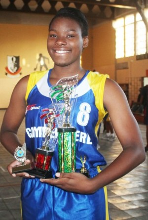 The season's Most Valuable Player in the National Sports Council's Wanda Agard Belgrave Championship, Latifah Wood of Combermere all smiles after receiving her trophies.