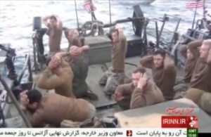 American sailors pictured on a boat with their hands on their heads at an unknown location in this still image taken from a recent video .