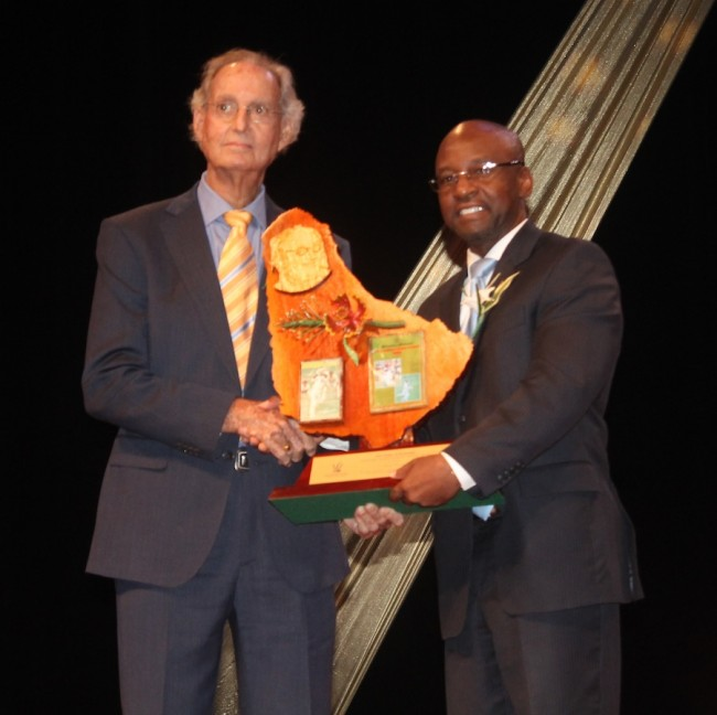 Veteran cricket broadcaster Tony Cozier received his Lifetime Achievement Award form Minister of Culture, Sports and Youth, Stephen Lashley.