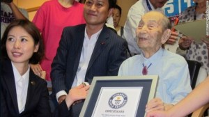 Yasutaro Koide, 112, receiving a Guinness World Records certificate as the oldest living man in August.
