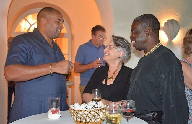 Minister of Tourism Richard Sealy with repeat visitors Dr Naomi Ervin and husband Gay Wharton in deep discussion.