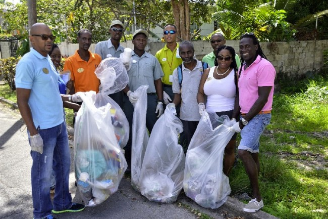 Members of the clean up team showing some of the trash they collected. Discarded car tyres were also among the items removed.