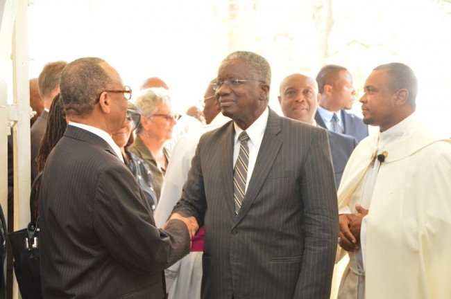 Prime Minister Freundel Stuart (center) greets Jean Holder at the entrance of the church with Rector of  St George Parish Church, Rev. John Rogers, to his right.
