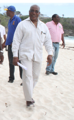 Minister of the Environment and Drainage Dr Denis Lowe walking along Foul Bay Beach yesterday.