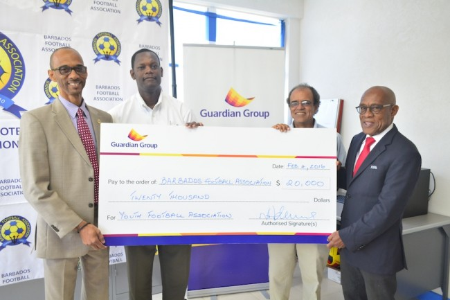 Guardian Life's Fabian Bishop (left) presented the sponsorship cheque to the BFA's Al Walcott (second left),  Pro Shottas' Greg Castagne and BFA's president Randy Harris (r).