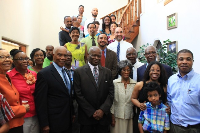 Governor General Sir Elliott Belgrave (center front) joined centenarian Myril Howell (standing to his right at front) and her family for a photo on her 100th birthday.