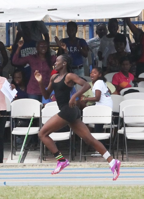 Lelani Haddock of Talma House during her record breaking performance in the under-15 girls 400m.