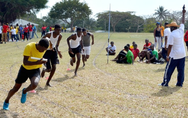 Mario Best of Yellow House takes off ahead of the field for the 4x400m in the final event at the Deighton Griffith School sports.
