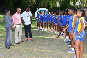 Scotiabank's Brian Clarke (second left) meets the athletes of Springer Memorial, also present are deputy principal of the school Mitchelle Maxwell (left) and coach Sean Dupigny (third left).