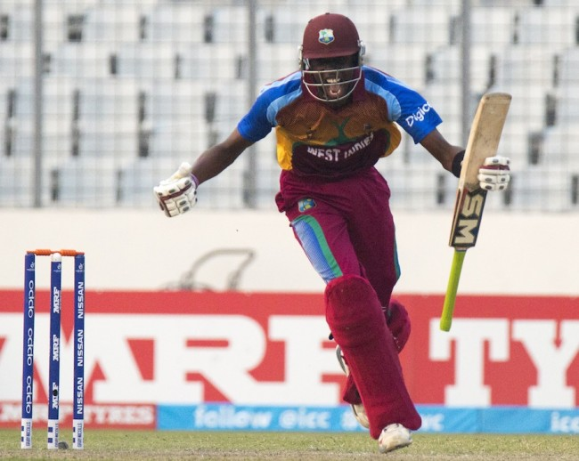 Man of the Match Shamar Springer screams his delight after hitting the winning runs to put West Indies into the World Cup final.