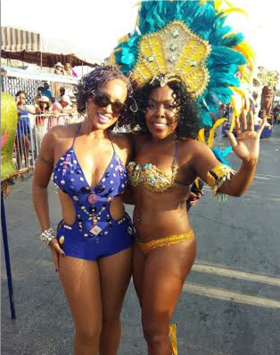 Soca Queen Alison Hinds and a reveller on the road.
