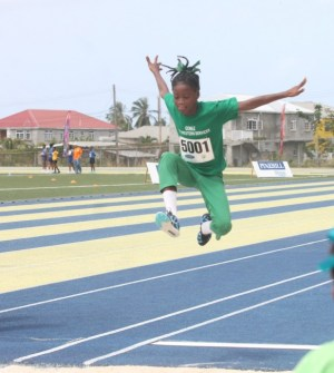 Victrix ludorum Deneisha Forde of St Catherine's Primary as she wins the U-11 long jump.
