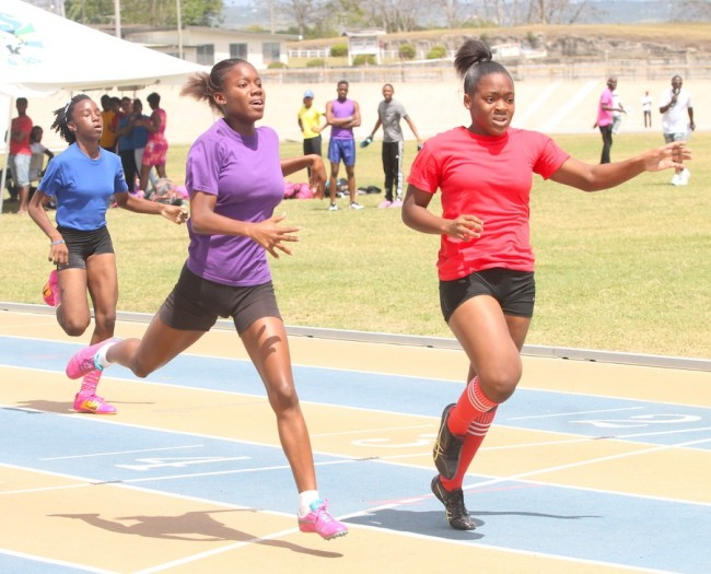 Zariah Knight of Victoria House held off stiff competition from Ashley Weekes of Elizabeth House in the under-15 girls 200m.