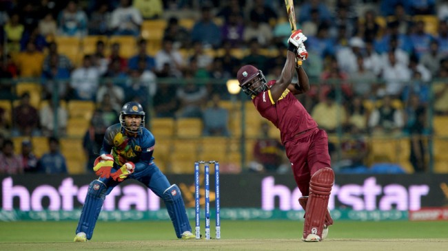 West Indies's Andre Fletcher plays a shot during the World T20 cricket tournament match between West Indies and Sri Lanka at the Chinnaswamy Stadium in Bangalore on March 20, 2016. The West Indies are chasing a target of 122 runs. / AFP / Kiran MANJUNATH        (Photo credit should read KIRAN MANJUNATH/AFP/Getty Images)