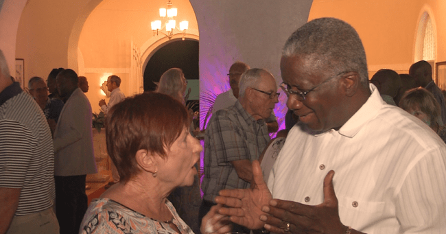 A smiling Prime Minister Freundel Stuart interacting with one of the repeat visitors.
