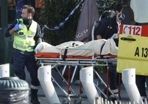 A victim being removed from the scene where shots were fired during a police search of a house in the suburb of Forest near Brussels, Belgium, today.