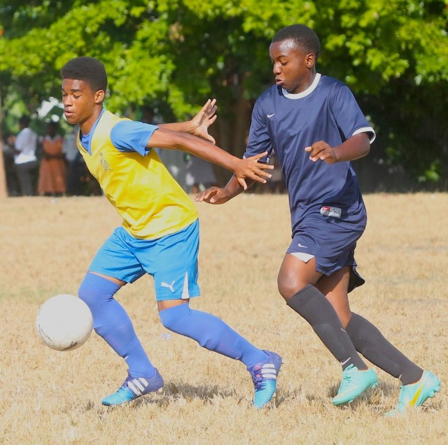 Aaron Wiltshere of Combermere tried to keep Nikybo Smith of Alexandra at bay.