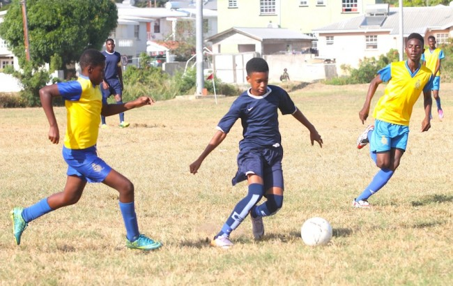 Alexandra goal scorer Quiro Gill made it look easy as he dribbled past (from left) Dicarlo Cox and Zidan Clarke of Combermere. (Pictures by Morissa Lindsay)