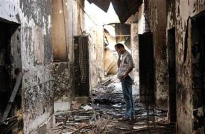 An employee of Doctors Without Borders walking inside the  charred remains of the organization's hospital after it was hit by an American air strike in Kunduz, Afghanistan.