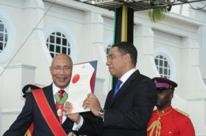 Newly sworn in Prime Minister Andrew Holness (right) with Governor General Patrick Allen today.