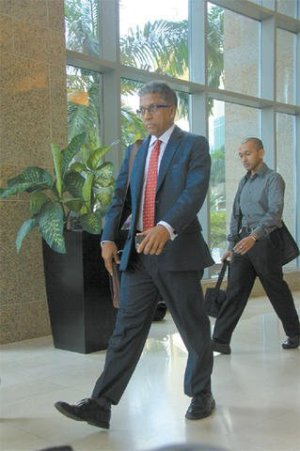 Attorney for steel company ArcelorMittal, Reginald Armour, SC, leaving Tower D Waterfront Centre, Wrightson Road, Port of Spain, yesterday after a meeting with Minister  of Labour Jennifer  Baptiste-Primus.