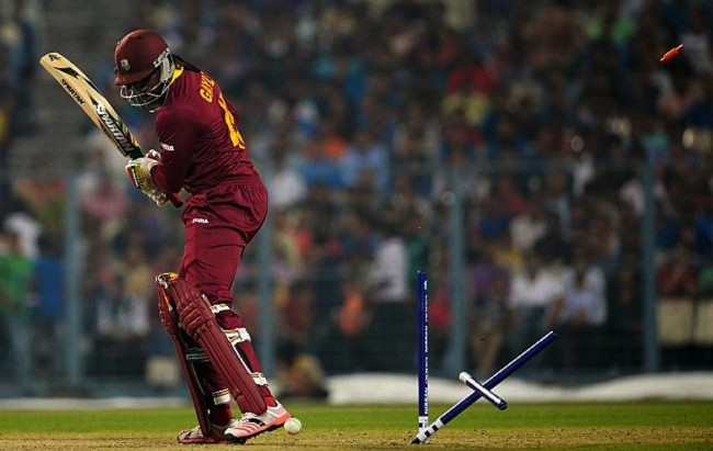 Chris Gayle has his stumps uprooted.