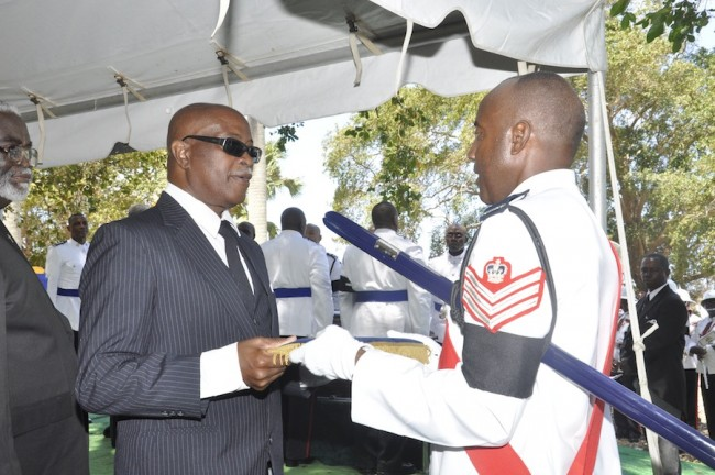 Clarence Clarke (at left), the son of former Senior Superintendent  Clyde Evanson Clarke receiving dad's badge at the graveside.