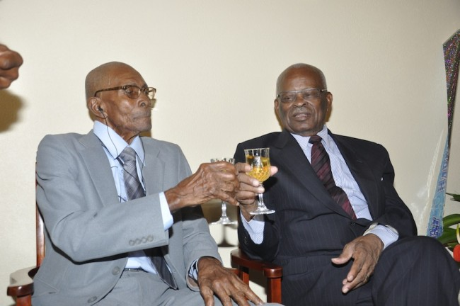 Centenarian Robert Springer and Governor General Sir Elliott Belgrave toast his 100.