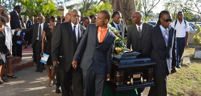 Pallbearers taking former  Central Bank Deputy  Governor Carlos Holder's body to its final resting place.