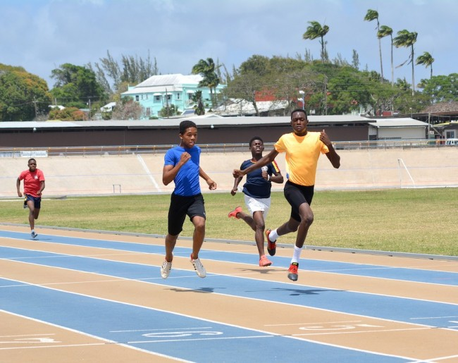 Delano Wichkam (right) pips joint victor ludorum winner Lee-Andre Walker on the line in the U17 boys 200m. (Pictures by Nku Davis)