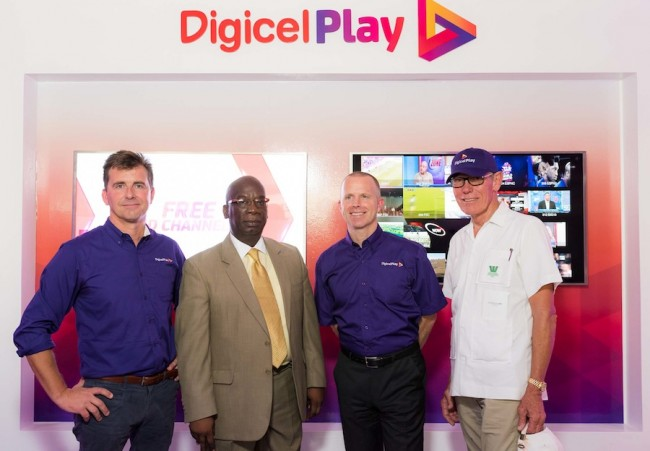 """From left, Digicel Play CEO Charlie Clementson, Minister of Education Ronald Jones, Digicel Barbados CEO Conor Looney and board member Ralph """"Bizzy"""" Williams."""