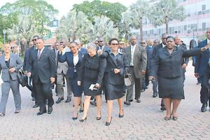 Prime Minister Perry Christie and members of his Cabinet walking to the House of Assembly yesterday to vote on four  constitutional ammendment bills.
