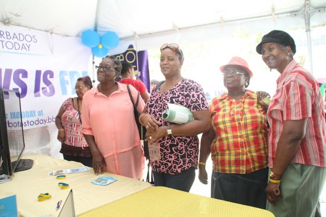 Interested visitors to Barbados TODAY'S booth at Agrofest.