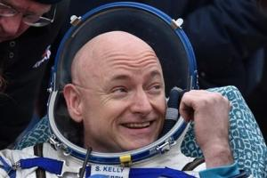 International Space Station (ISS) crew member Scott Kelly of the United States reacting after landing near the town of Dzhezkazgan, Kazakhstan, today.