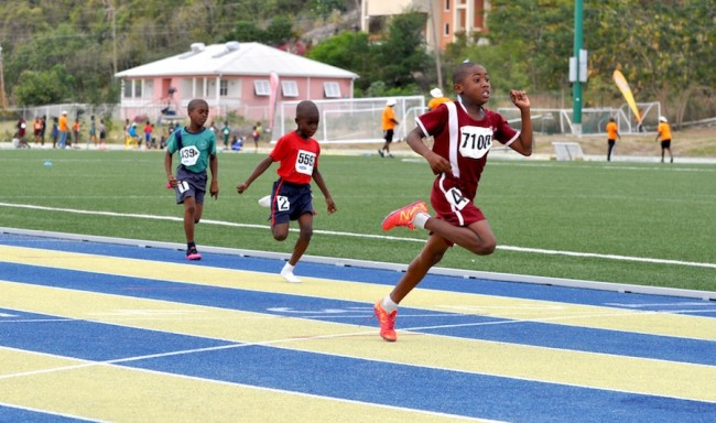 Jonathan Thompson broke the line in the Boys U9 100m in 15.22sec ahead of Aren Beckles (red) and Roshae Broome.