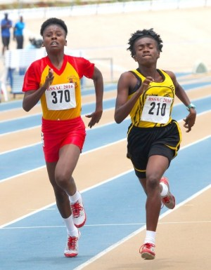 Mary Fraser of Daryll Jordan Secondary (left) showed lots of determination to defeat her cousin Elizabeth Williams of Christ Church Foundation in the under-20 girls 1500m.