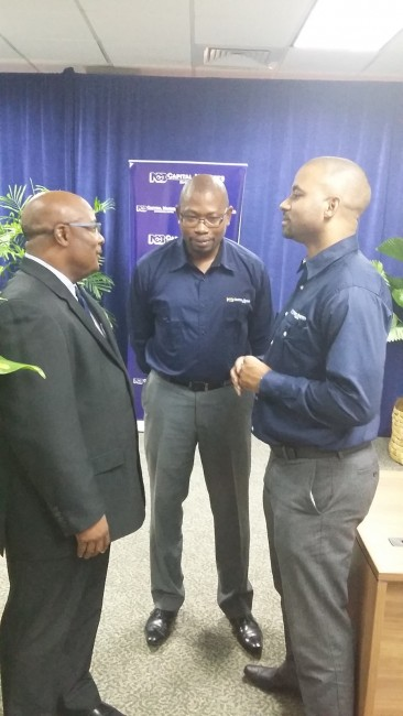 From left, Parliamentary secretary in the Ministry of Finance and Economic Affairs Senator Jepter Ince, Chief Executive Officer of NCB Capital Market (Barbados) Limited, Warwick Ward and Chief Executive Officer of the Jamaica-based NCB Capital Market Limited Steven Gooden.