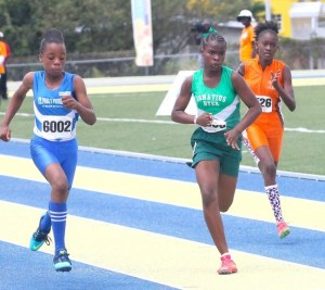 Naomi Forde-Hinds of St Paul's Primary (left) set a new time in the under-13 girls 100m.