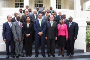Prime Minister Andrew Holness (front row centre) and members of his cabinet after they were sworn in yesterday at King's House.