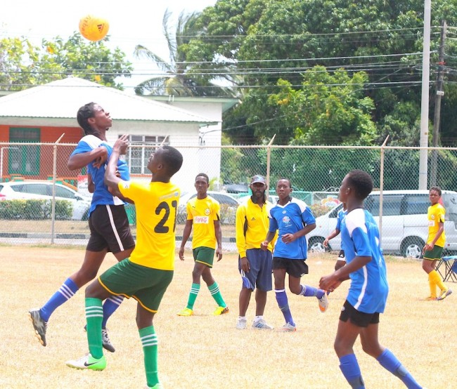 Sharif Mondore of Pro Shottas heads the ball away from danger in the under-15 clash against Kick Start.