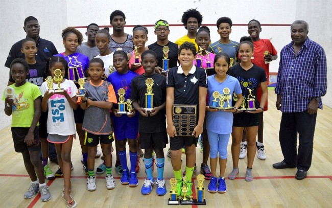 Winners and runners-up show off their trophies and awards at the end of the squash championships. At left is Sagicor executive Roger Spencer and at right is Barbados Squash Association president Monty Cumberbatch. (BB)