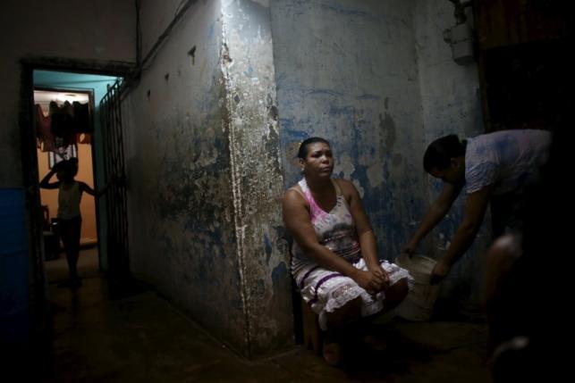 Yolanda Sanchez, 44, sits in her home in Havana, March 19, 2016. REUTERS/Alexandre Meneghini