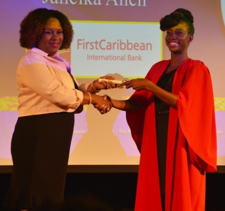CIBC FirstCaribbean's Debra King presenting the bank's scholarship to Janeika Allen.