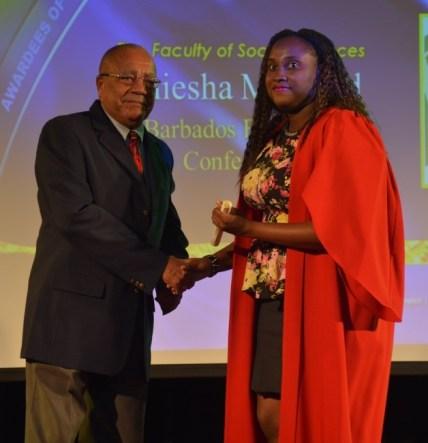 Barbados Employers Federation executive director Tony Walcott presenting that organization's scholarship award to Daniesha Maynard.