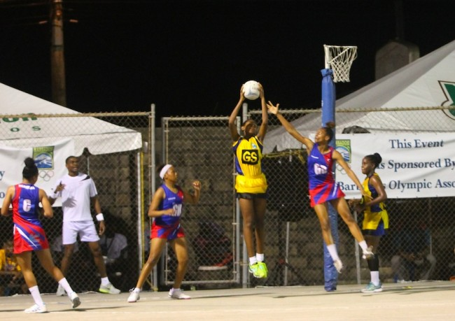 Barbados goal-shooter Tower Lorde (with ball) and goal-attack Brianna Holder (right) led the way for Barbados. (Pictures by Morissa Lindsay).