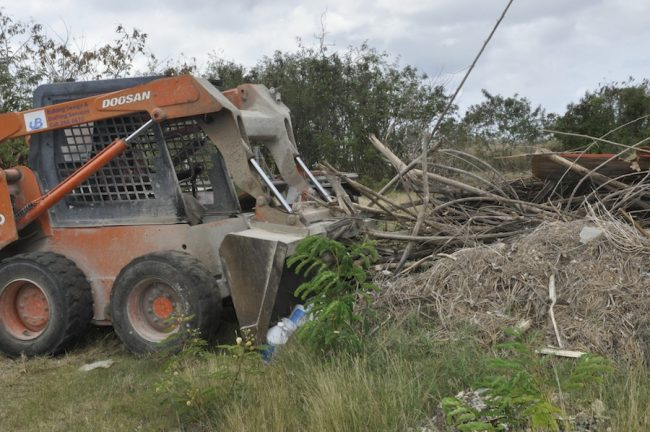 This Bobcat was sent by the private hauler to clear the illegal waste, after his company was caught dumping illegally at Christie Village, St Thomas over the weekend.