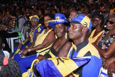 Proud Barbadians decked out in the National Colours.